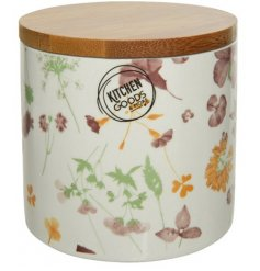 A pretty purple, orange and green floral storage pot with a natural wooden lid.