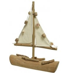 A rustic living decorative boat made from driftwood and seashells.