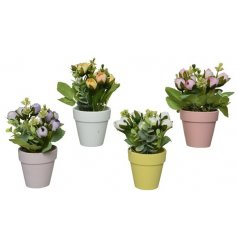 An assortment of 4 pretty pastel plant pots filled with fine quality artificial flowers.