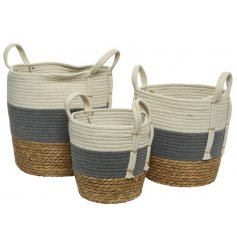 A set of 3 natural woven baskets in cream and grey colours. Complete with handles.