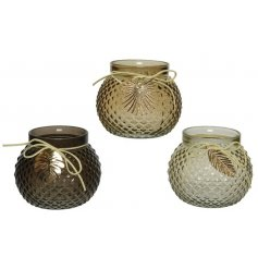 A mix of 3 glass relief candle holders in rich brown and natural colours.