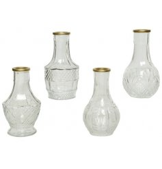 An assortment of 4 vintage inspired transparent glass vases. Each is beautifully detailed and has a gold rim.