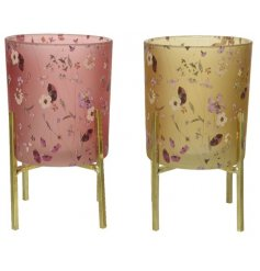 An assortment of 2 stunning glass t-light holders with gold stand. In pink and yellow designs