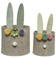 A set of 2 unique and totally charming felt storage baskets in the shape of bunnies.