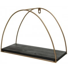 A chic arched brass shelf with a rustic black painted shelf. A must have for the style savvy.