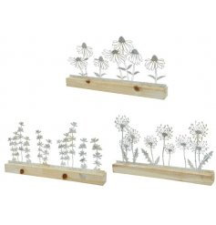 An assortment of 3 stunning floral sculptures made from iron. Set within a white washed wooden stand.