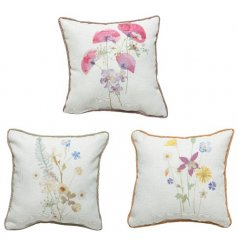 An assortment of 3 pretty floral cushions depicting wild flowers. Each is printed and is finished with piping.