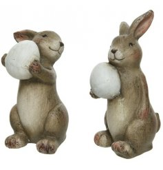 An assortment of 2 charming terracotta bunny decorations, complete with egg.