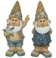 A mix of 2 unique gnome decorations. Each is dressed in flip flops and is adorned with coastal decorations.