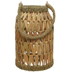 A natural woven lantern made from seagrass. Complete with glass insert.