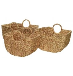 A set of 3 natural woven baskets with handles. Each is handmade with a chic plaited design.