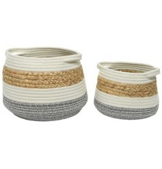 A set of 2 natural, white and grey woven storage baskets with handles.