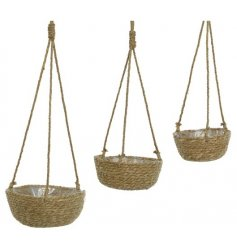 A set of 3 handmade woven hanging baskets. Made from sea grass with jute hangers.
