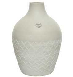 A beautifully simple white terracotta vase with a hand drawn triangle pattern.