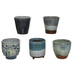 A mix of 5 beautifully glazed terracotta pot planters. Each has a unique design and a handmade aesthetic.