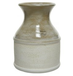 A simple living two-tone terracotta vase in natural white and brown colours.