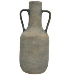 A tall and beautifully simple terracotta vase with handles and a black washed finish.