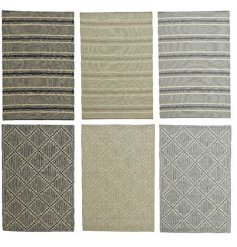 An assortment of grey and natural rugs. The mix includes both stripe and diamond designs.