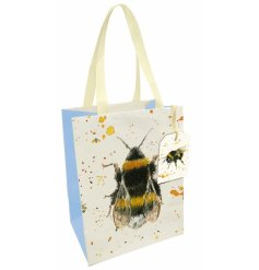 A charmingly designed gift bag complete with yellow ribbon handles and a matching gift tag