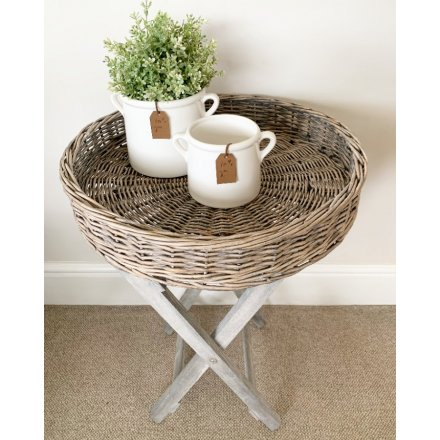 A super stylish and practical wicker table tray with a grey washed finish.