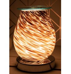 Inspired by the sands of the Sahara desert, this glass based LED Oil burner is a must have in any home
