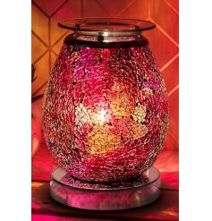 Set with a crackle inspired decal surrounding, this pink and orange hued aroma lamp will be sure to add a relaxing feel