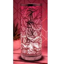 A luxury table lamp with a bold leaf design and shimmering pink hue. A stunning, on trend feature for the home which loo