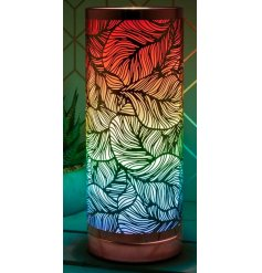 A sleek silver touch table lamp with a large, leaf decoration, perfectly set with a rainbow toned glow