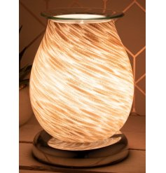 Decorated with a gorgeous sandy wave inspired design, this warm glowing centred oil burner will be sure to place perfect
