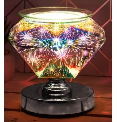 Set with a Diamond Shaped Design, this Desire Aroma Lamp features a gorgeous 3D effect patterned glow