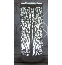 A beautifully elegant metal aroma lamp featuring a woodland tree cut decal and bright white LED Glow