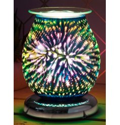 Decorated with a gorgeous multi colour 3D star effect, this warm glowing centred oil burner will be sure to place perfec