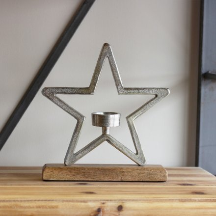 A charming and rustic inspired aluminium star ornament on a natural wooden block base