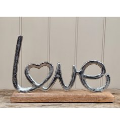 Sure to bring a charming country vibe to any hallway or home space , a decorative Love Sign with a rustic edge and natur