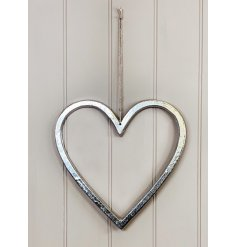 A small and simplistic ornamental heart set with a distressed feature and jute string hanger