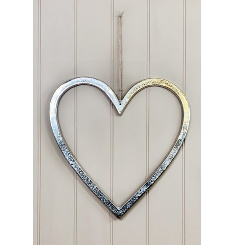 A rough luxe inspired heart decoration with a textured silver aluminium finish. Complete with a long jute string hanger.