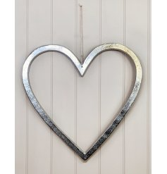 A large and simplistic ornamental heart set with a distressed feature and jute string hanger