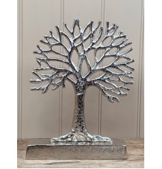A beautifully distressed inspired ornamental tree of life decoration, set with a sleek silvered tone