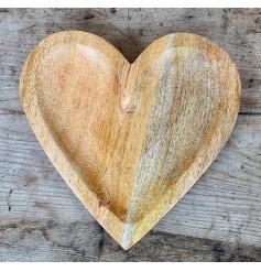 A simplistic natural wood heart dish,