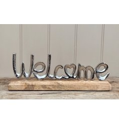 A rustic inspired welcome decoration with a textured surface finish.
