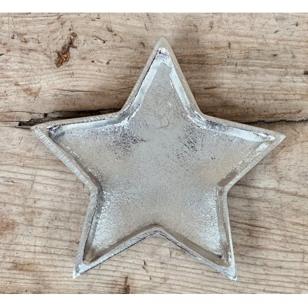 An overly distressed silver star plate, a perfect little ornament to add to your home