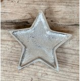 An overly distressed aluminium star dish, perfect for tlight use at Christmas