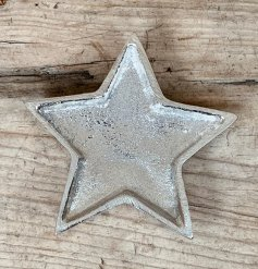 An overly distressed silver star dish, a perfect little ornament to add to your home