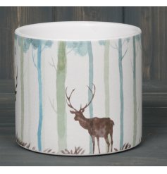 Sure to bring a Wintered Woodland sense to any home space, a sturdy terracotta pot beautifully decorated with a woodland