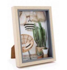 A chunky wooden framed picture stand featuring a sold grey toned edging
