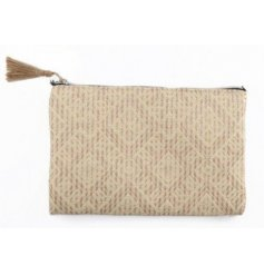 A woven fabric bag with a zip tassel and subtle diamond print decal