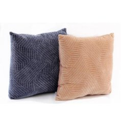 An assortment of decorative Scatter Cushions each set with Terracotta and Navy colour tone and embossed pattern