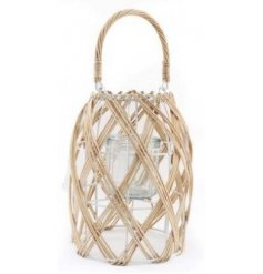 A charmingly simple woven lantern set with a neutral colour tone