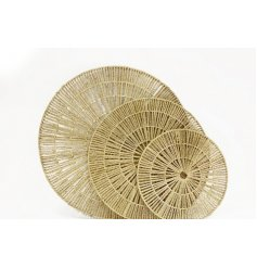 An assorted sized set of round natural woven wall decals with a simplistic feature to each