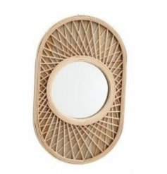 a decorative wall mirror in an oval shape with an overlapped wooden slat decal